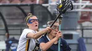 Massapequa's Erin Tierney breaks up Oceanside's Alison Schwasnick's