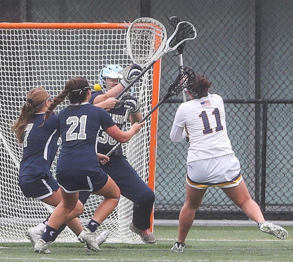 Massapequa's Alexa Gentile puts the ball behind Oceanside's