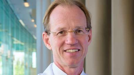 Dr. Thomas McGinn, of Manhattan, has been promoted