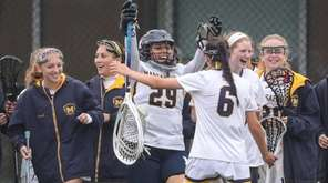 Massapequa celebrates its 12-10 win around goaltender Sophia