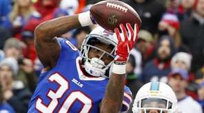 Buffalo Bills cornerback Corey White (30) intercepts a