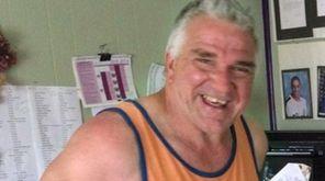 Edward Sinnott, 59, of Huntington, died while installing