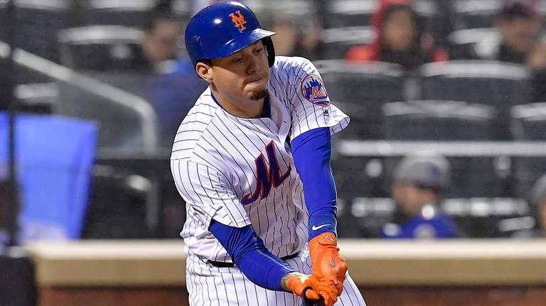 Wilmer Flores of the New York Mets strikes