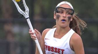 Syosset's Taylyn Stadler moves the ball around the
