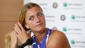 Petra Kvitova of the Czech Republic adjusts her