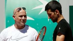 Novak Djokovic, right, talks with his new coach
