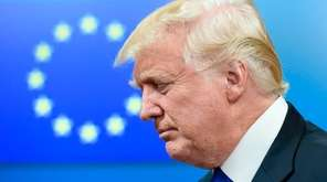 President Donald Trump leaves a meeting with EU