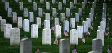 American flags are placed at graves at Arlington