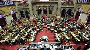 Members of the New York Assembly work on