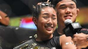 Singapore's Angela Lee (C) celebrates with family members