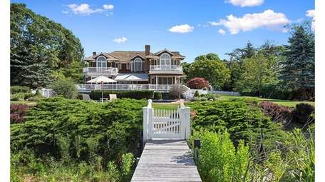 This eight bedroom, 8 ½-bath Quogue home sits