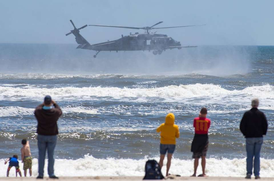Spectators watch the Air National Guard Blackhawk helicopter