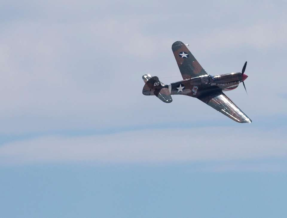 Spectators watch as the Warbirds perform during the