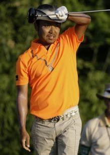 Shingo Katayama, of Japan, watches his ball after