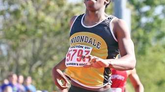 Uniondale's Christopher Borzor wins the boy's 400 meters
