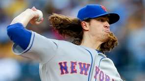 New York Mets starter Jacob deGrom pitches against