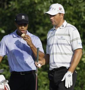 Tiger Woods, left, and Padraig Harrington, of Ireland,