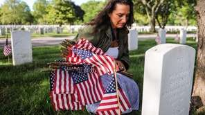 Kimberlie Liccardi, of Huntington, reflects while kneeling at