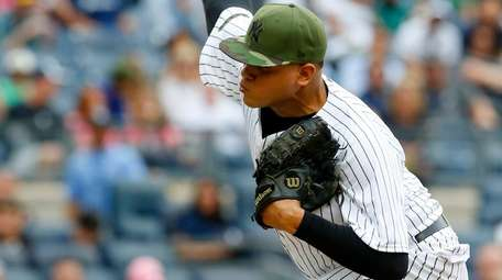 Dellin Betancesof the New York Yankees pitches in