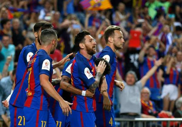 Barcelona's Lionel Messi, second right, celebrates with teammates
