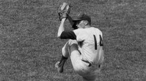 Jim Bunning of the Philadelphia Phillies wipes sweat from