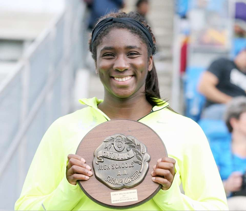 St. Anthony's Halle Hazzard pses with her plaque