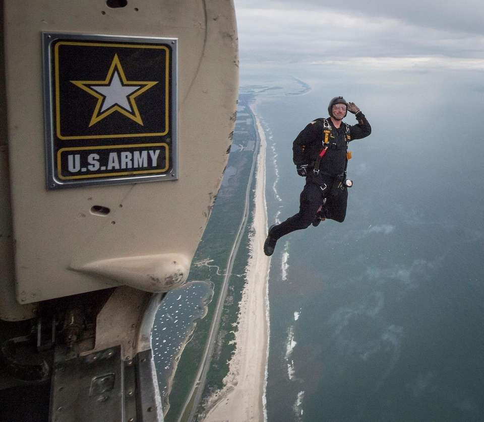A Golden Knights parachutist jumps from the UV-18C,