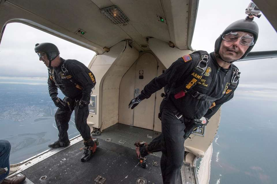 The Golden Knights parachuters jump from the UV-18C,