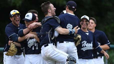 Players from Plainview-Old Bethpage JFK celebrate their 5-4