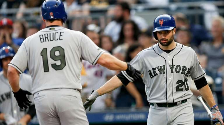 New York Mets' Jay Bruce is greeted by