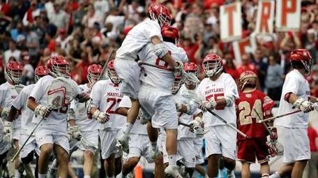 Maryland's goalkeeper Dan Morris jumps to celebrate with