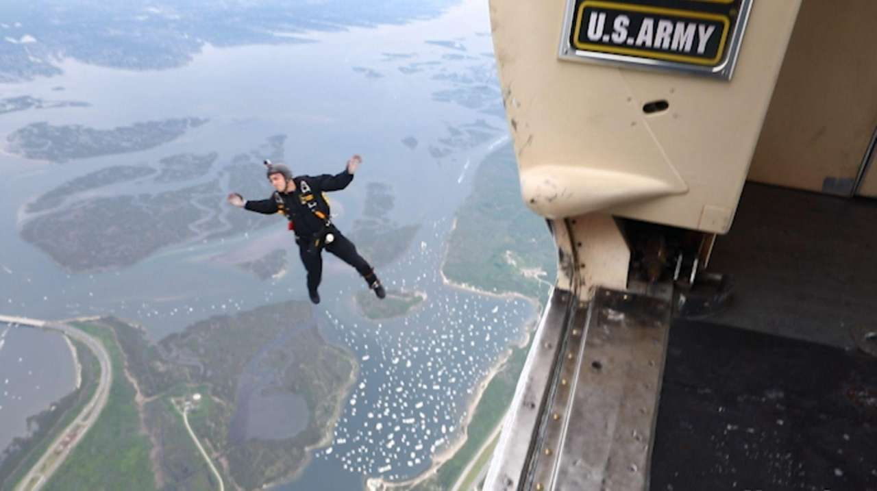 The ArmyGolden Knights parachute team geared up to