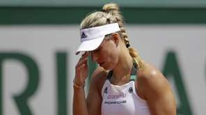 Germany's Angelique Kerber reacts after missing a shot