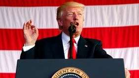 President Donald Trump speaks to U.S. military troops