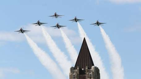 The Air Force Thunderbirds fly in Delta formation