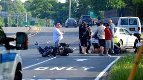 People at the scene after a crash involving