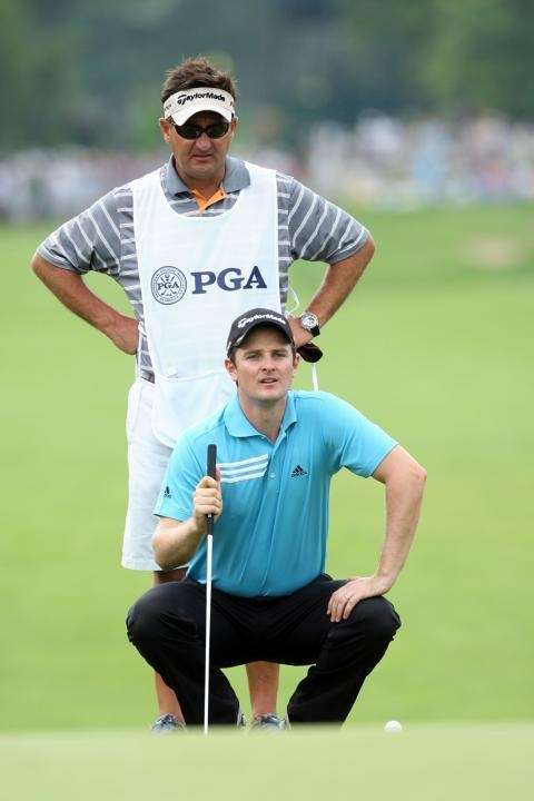Justin Rose of England lines up a putt