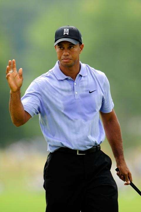 CHASKA, MN - AUGUST 13: Tiger Woods waves