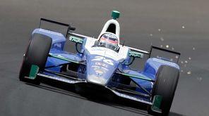 Takuma Sato, of Japan, drives through the first