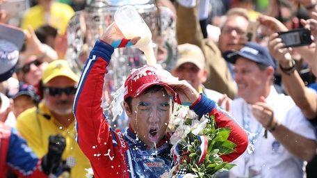 Japanese driver Takuma Sato of Andretti Autosport celebrates