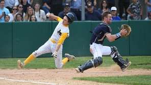 Michael Cottone of Massapequa slides behind Christian DeNave