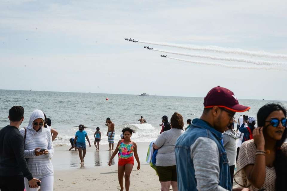 Stunt planes fly above the ocean at Jones