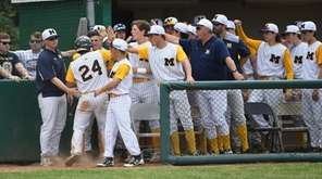 Massapequa players greet Andrew Primm after he scored