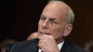 Homeland Security Secretary John Kelly listens on Capitol