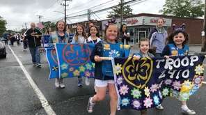Daisy Troop 2410 marches up Merrick Avenue Monday,