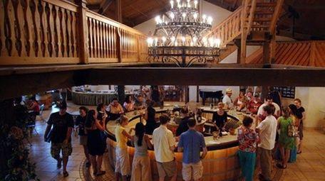 Visitors taste wines at Raphael Vineyards.
