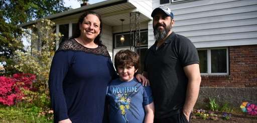 Jennifer and Shalom Gordon with son Philip, 7,