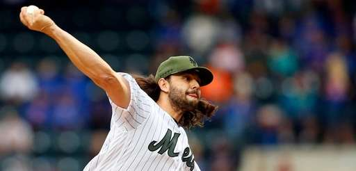 Robert Gsellman of the Mets pitches in the