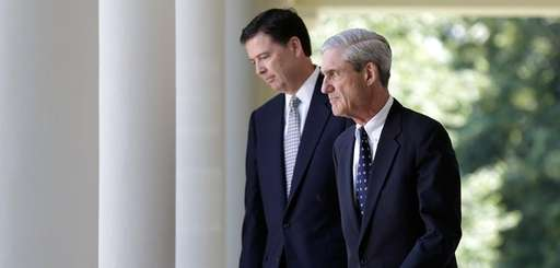 Then-incoming FBI Director James Comey, left, with then-outgoing