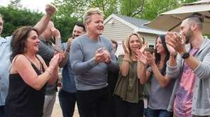 Chef Gordon Ramsay, center, celebrates with members of